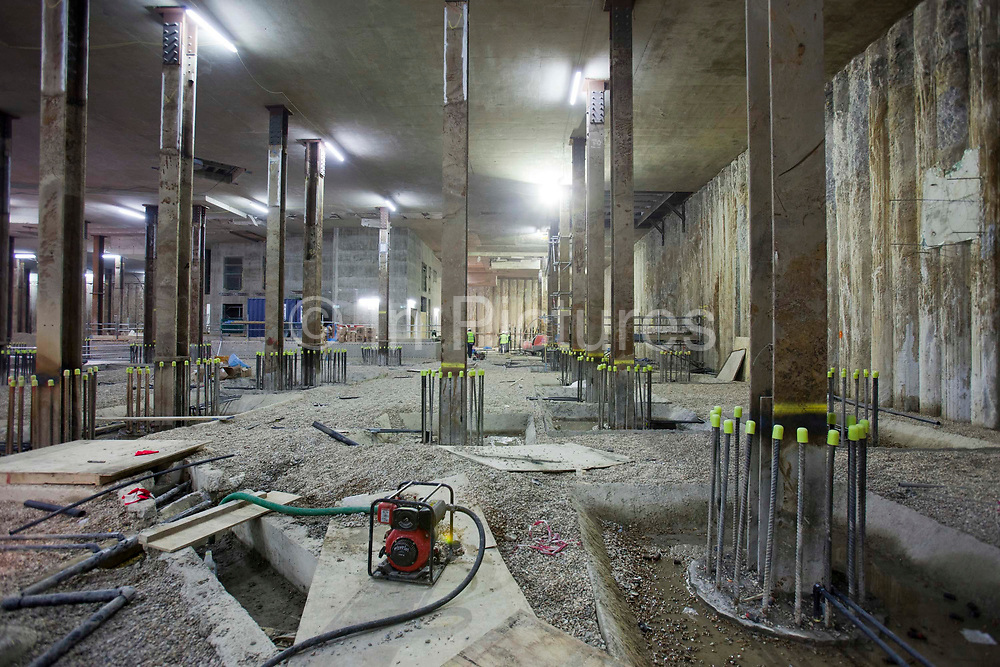 Heat pumps being installed deep underground in the City of London. Geothermal International's heat pumps provide both heating and cooling for commercial buildings