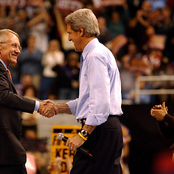John Kerry            ..Nevada Sen. Harry Reid shakes hands with Massachusetts Sen. John Kerry during a rally for his presidential campaign inside Lawlor Events Center in Reno, Nev. Oct. 21, 2006...Photo by David Calvert