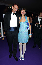 Chairman of the ball JAMES JOHNSTONE and his wife CAROLINE  at The British Red Cross London Ball - H2O The Element of Life, held at The Room by The River, 99 Upper Ground, London SE1 on 17th November 2005.<br />