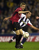 Photo. Richard Lane.<br />West Bromwich Albion v Manchester United. Carling Cup 4th Rd. 03/12/2003.<br /><br />Manchester's Darren Fletcher and West Brom's Daniele Dichio challenge for the ball.