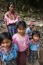 Mayan family in river, near Lake Atitlán, Guatemala