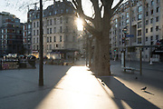 """March, 23rd 2020 - Paris, Ile-de-France, France: Virtually empty areas of northern Paris, confinement to prevent the spread of the Coronavirus, during the eigth day of near total lockdown imposed in France. A week after President of France, Emmanuel Macron, said the citizens must stay at home from midday on Tuesday for at least 15 days. He said """"We are at war, a public health war, certainly but we are at war, against an invisible and elusive enemy"""". All journeys outside the home unless justified for essential professional or health reasons are outlawed. Anyone flouting the new regulations is fined. Nigel Dickinson"""