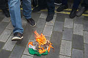 As Indians celebrate their Independence Day, Kashmiris and Pakistanis surround a burning Indian flag outside India House, the Indian High Commission in Londons Aldwych, during a protest about Indian PM Narendra Modis recent decision to strip Indian-administered Kashmir of its special status, London, on 15th August 2019, in London, England.
