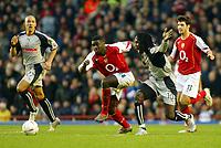Photo. Chris Ratcliffe, Digitalsport<br /> Arsenal v Stoke City. FA Cup Third Round. <br /> 09/01/2005<br /> Ade Akinbiyi challenges Kolo Toure at Highbury as Stoke lose 2-1.