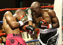 Michael Nyawade (R) of Kenya Punch David Rajwili of South Africa during their Mac Series Professional Boxing Bonaza at Safaricom Indoor Arena in Nairobi on November 5, 2016. Rajwili won. Photo/Fredrick Onyango/www.pic-centre.com (KEN)