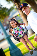 Dad Pushes His Daughter on the Swings at George Washington Park in Anaheim