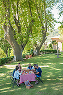 Enjoying a picnic on the grounds of the Chateau Pesquie winery and estate in the Rhone Valley of France.
