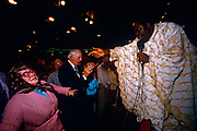 In a somewhat chaotic moment in proceedings, the late evangelical preacher Dr Benson Andrew Idahosa is said to be driving evil spirits from a lady who passes out and falls backwards during a ministry at Butlins holiday centre in Minehead, Somerset, England. Other members of the congregation are happily clapping at the power of Jesus during a week of Christian meetings and events led by visiting preachers and church leader. Benson Andrew Idahosa (1938 - 1998) was a Charismatic Pentecostal preacher, founder of the Church of God Mission International with headquarters in Benin City, Nigeria and known as the first Pentecostal archbishop in Nigeria