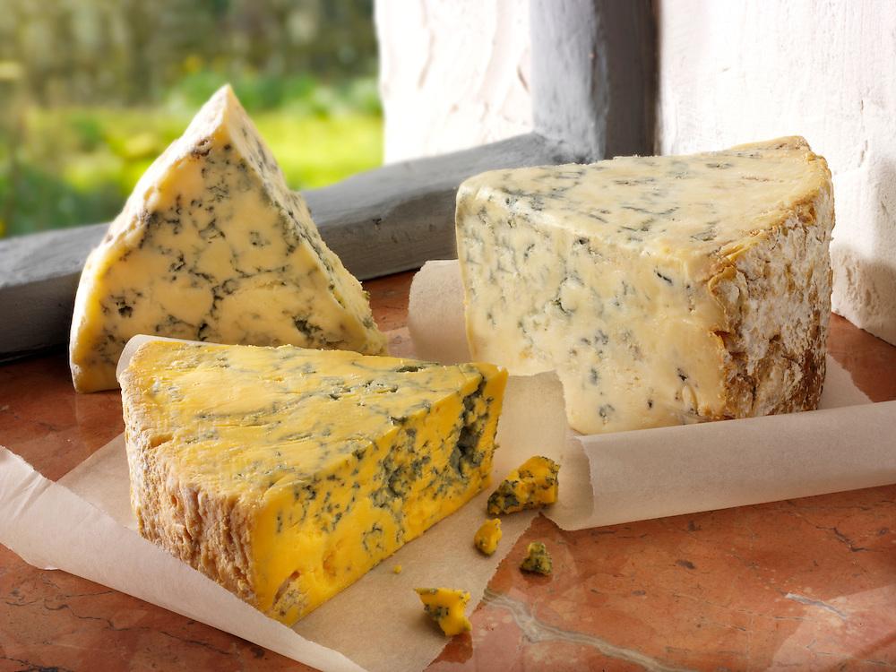 Blue and white stilton and Creamy Blacksticks cheese photos. Funky Stock Photos