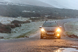 © Licensed to London News Pictures. 29/09/2020. Hay-on-Wye, Powys, Wales, UK. A sudden violent blizzard catches motorists unawares at Hay Bluff in the Brecon Beacons National Park, in Powys, Wales, UK. Photo credit: Graham M. Lawrence/LNP