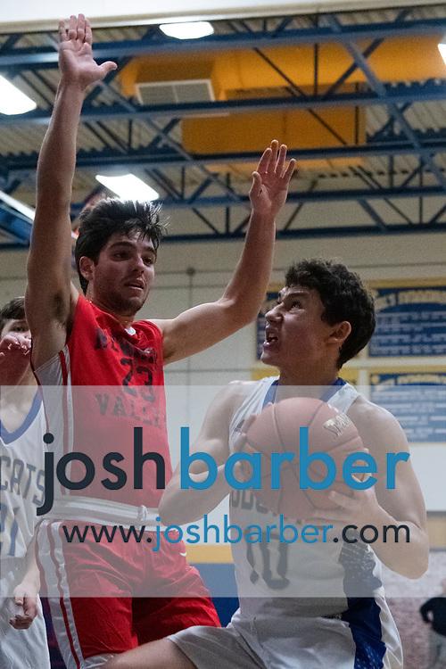 Newark Valley's Jason Graham, Lansing's Ben Vincent during the game at Lansing High School on Thursday, December 20, 2018 in Lansing, New York. (Photo/Josh Barber)