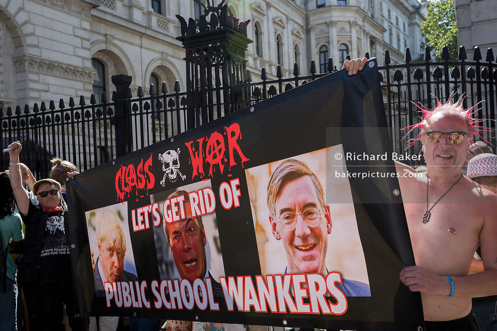 On the day that Britain's new Conservative Party Prime Minister, Boris Johnson enters Downing Street to begin his government administration, replacing Theresa May after her failed Brexit negotiations with the European Union in Brussels, Class War protesters stretch their classist banner outside Downing Street, on 24th July 2019, in Westminster, London, England.