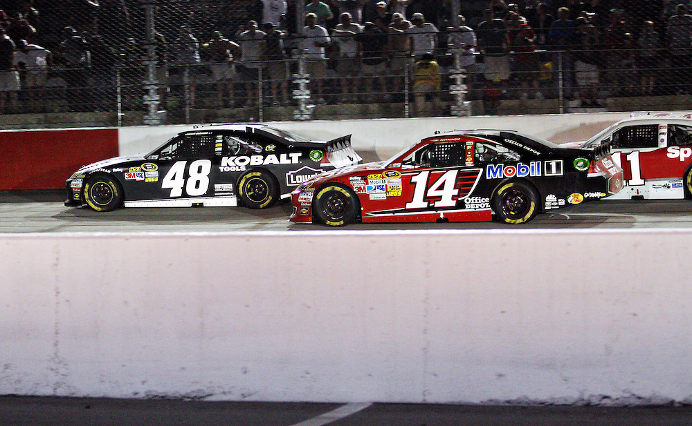 May 12, 2012; Darlington, SC, USA; NASCAR Sprint Cup drivers Jimmie Johnson (48) and Tony Stewart (14) during the Southern 500 at Darlington Raceway. Mandatory Credit: Peter Casey-US PRESSWIRE.