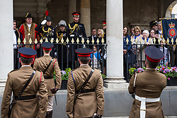 Windsor, UK. 18 May, 2019. Princess Anne, Princess Royal, salutes from the Guildhall as the Household Cavalry exercise their right to a Freedom of Entry March through Windsor by way of a farewell to the town where they have been based for over 200 years in advance of their relocation to Salisbury Plain later this year. The march comprised up to 250 marching troops, 8 mounted troops, the Band of the Household Cavalry and veterans.