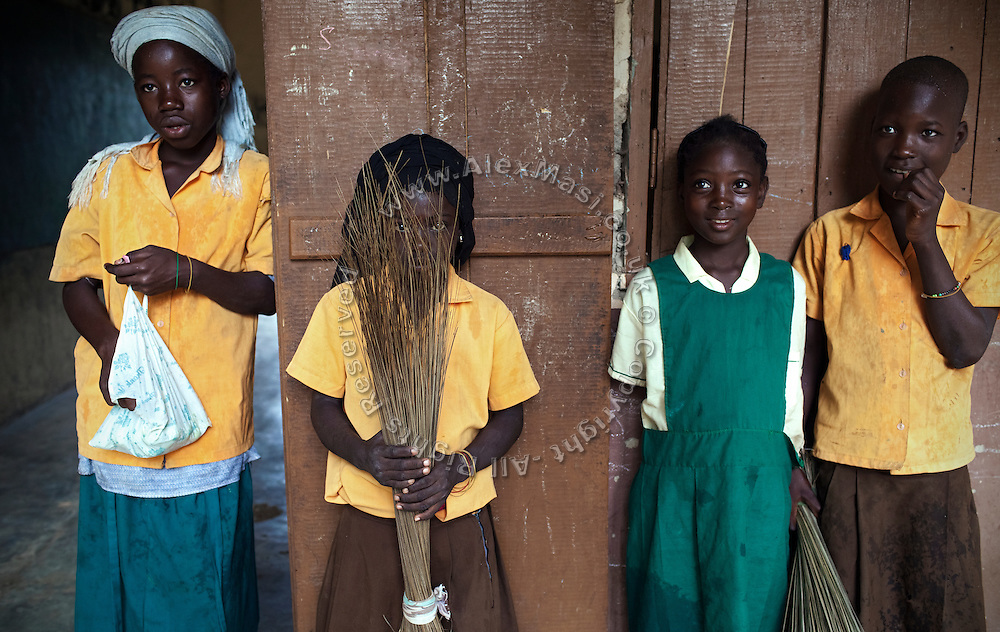 During recreational time, Hassana Ibrahim, 11, (second from right) her classmate Rahima Ibrahim, 11, (second from left, not sisters) and other pupils are spending some time together in the courtyard of their school in Boggu, Tamale, northern Ghana.