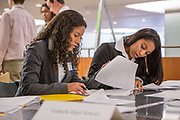 Purchase, NY – 31 October 2014. Valhalla High School team members Daniela Espinosa, left, and Gabrielle Orr review their case notes. The Business Skills Olympics was founded by the African American Men of Westchester, is sponsored and facilitated by Morgan Stanley, and is open to high school teams in Westchester County.