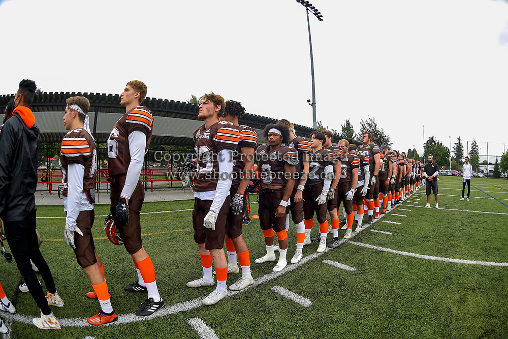 CHILLIWACK, BC - SEPTEMBER 11: The Okanagan Sun stand on the sideline for the national anthem against the Westshore Rebels at Exhibition Stadium in Chilliwack, BC, Canada. (Photo by Marissa Baecker/Shoot the Breeze)