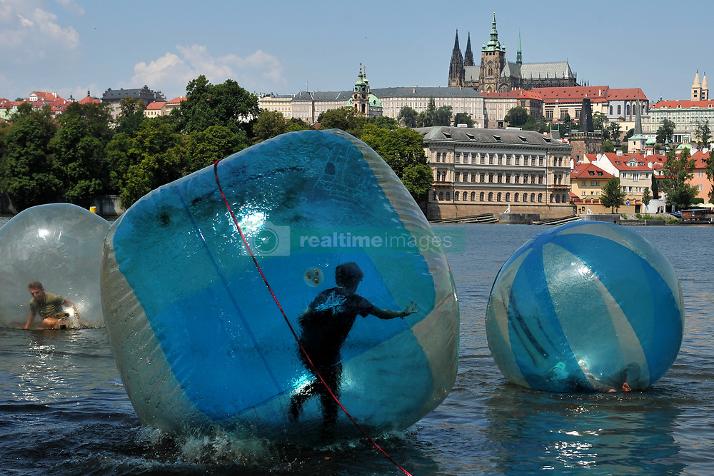 July 5, 2018 - Prague, Czech Republic - Tourists play in zorb balls on the Vltava river as temperatures reach 31 degrees Celsius Tourists play in zorb balls on the Vltava river in Prague, in the Czech Republic, July 5, 2018. Meteorologists predict summer temperatures of around 30 degrees Celsius in the Czech Republic over coming days. (Credit Image: © Slavek Ruta via ZUMA Wire)