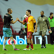 Galatasaray's Arda TURAN (C) and Trabzonspor's Burak YILMAZ (L) during their Turkish superleague soccer derby match Galatasaray between Trabzonspor at the TT Arena in Istanbul Turkey on Sunday, 10 April 2011. Photo by TURKPIX