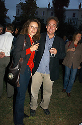 TV presenter JONATHAN MAITLAND and his wife at a party to celebrate the publication of Notting Hell by Rachel Johnson held in the gardens of 1 Rosmead Road, London W11 on 4th September 2006.<br /><br />NON EXCLUSIVE - WORLD RIGHTS