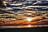 Beautiful beach sunset along the Mississippi Gulf Coast, near the Biloxi Lighthouse.