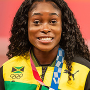TOKYO, JAPAN August 7:  Elaine Thompson-Herah of Jamaica with her third gold medal of the games on the podium after winning the 4 x 100m relay for women to add to her wins in the 100m and 200m for women during the Track and Field competition at the Olympic Stadium at the Tokyo 2020 Summer Olympic Games on August 7th, 2021 in Tokyo, Japan. (Photo by Tim Clayton/Corbis via Getty Images)