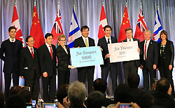 Canadaian Prime Minister Justin Trudeau (4th, R), Chinese Ambassador to Canada Luo Zhaohui (5th, L), Canada's Ontario's Premier Kathleen Wynne (4th, L), Toronto Mayor John Tory (3rd, R), China's Consul General in Toronto Xue Bing (3rd, L), Toronto Zoo CEO John Tracogna (2nd, R) and Chair of Toronto Zoo Board of Management Raymond Cho (2nd, L) and other guests attend the christening at the Toronto Zoo in Toronto, Canada, on March 7, 2016. The Toronto Zoo officially revealed the names of the first Canadian-born twin giant panda cubs on Monday: Jia Panpan (meaning Canadian Hope) for the male cub and Jia Yueyue(meaning Canadian Joy) for the female cub. Their mother, Er Shun, is on loan from China along with a male giant panda named Da Mao in 2013. EXPA Pictures © 2016, PhotoCredit: EXPA/ Photoshot/ Zou Zheng<br /> <br /> *****ATTENTION - for AUT, SLO, CRO, SRB, BIH, MAZ, SUI only*****