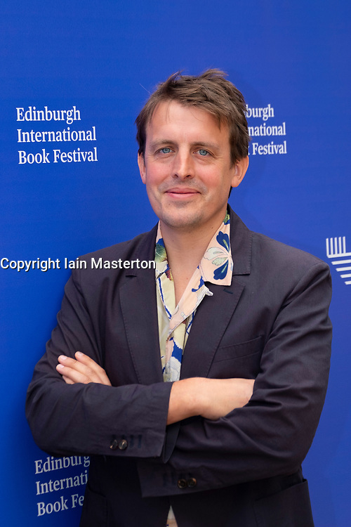 """Edinburgh, Scotland, UK. 26 August, 2018. Pictured; Oliver Bullough the investigative journalist. In """"Moneyland"""" he glues together the Panama Papers, Trumpism and inequality to expose the super-rich."""