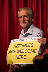 "© Licensed to London News Pictures. 05/09/2015. Margate, UK.  JEREMY CORBYN posing with a ""REFUGEES ARE WELCOME SIGN"" after the event. Labour leadership candidate JEREMY CORBYN taking part in a rally in Margate in Kent, UK today (SAT).  Corbyn is currently the favourite to be announced as the new Labour party leader on September 12th. Photo credit: Ben Cawthra/LNP"