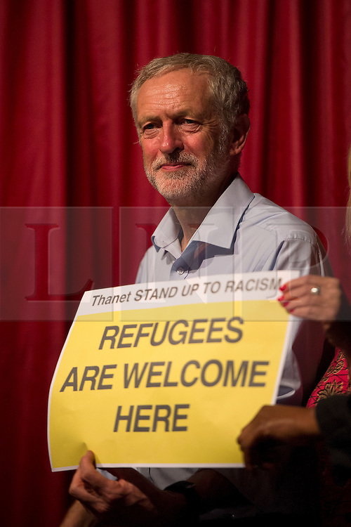 """© Licensed to London News Pictures. 05/09/2015. Margate, UK.  JEREMY CORBYN posing with a """"REFUGEES ARE WELCOME SIGN"""" after the event. Labour leadership candidate JEREMY CORBYN taking part in a rally in Margate in Kent, UK today (SAT).  Corbyn is currently the favourite to be announced as the new Labour party leader on September 12th. Photo credit: Ben Cawthra/LNP"""