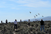 Photographers line up in the infield of pigeon 3 to capture a heat of T6s roaring by during the 2015 Reno Air Races.