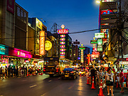 """18 MAY 2017 - BANGKOK, THAILAND:  Yaowarat Road in Bangkok's Chinatown is the heart of the city's street food industry. City officials in Bangkok have taken steps to rein in street food vendors. The steps were originally reported as a """"ban"""" on street food, but after an uproar in local and international news outlets, city officials said street food vendors wouldn't be banned but would be regulated, undergo health inspections and be restricted to certain hours on major streets. On Yaowarat Road, in the heart of Bangkok's touristy Chinatown, the city has closed some traffic lanes to facilitate the vendors. But in other parts of the city, the vendors have been moved off of major streets and sidewalks.     PHOTO BY JACK KURTZ"""