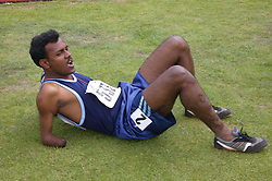 British Open Athletics Championships 2003 games; disabled athlete resting after taking part in a track event,