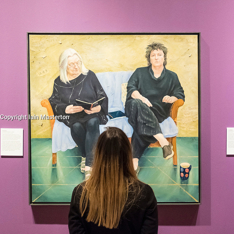 Edinburgh, Scotland, United Kingdom. 14 December, 2017. <br /> Jill Brown, Press and Marketing Officer at National Galleries Scotland, looks at painting The Poets by Claire Eastgate at the exhibition of BP Portrait Award 2017.<br /> The BP Portrait Award 2017 opens at the Scottish National Portrait Gallery on 16 December 2017.