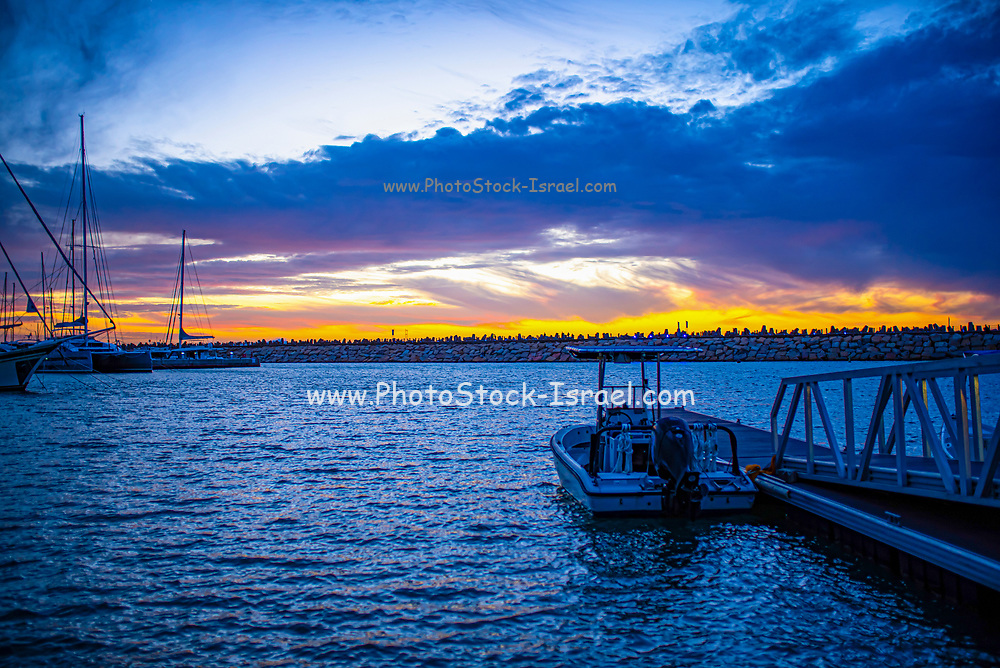 Yacht masts are silhouetted by a beautiful Mediterranean Sun Set. Photographed in Israel