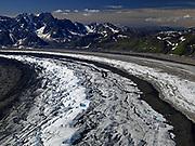 Aerial view of the Ruth Glacier curving past the Tokosha Mountains, Denali National Park, Alaska.