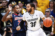 SHOT 1/21/12 5:36:04 PM - Colorado's Carlon Brown #30 tries to back down Arizona's Kyle Fogg #21 during their PAC 12 regular season men's basketball game at the Coors Events Center in Boulder, Co. Colorado won the game 64-63..(Photo by Marc Piscotty / © 2012)