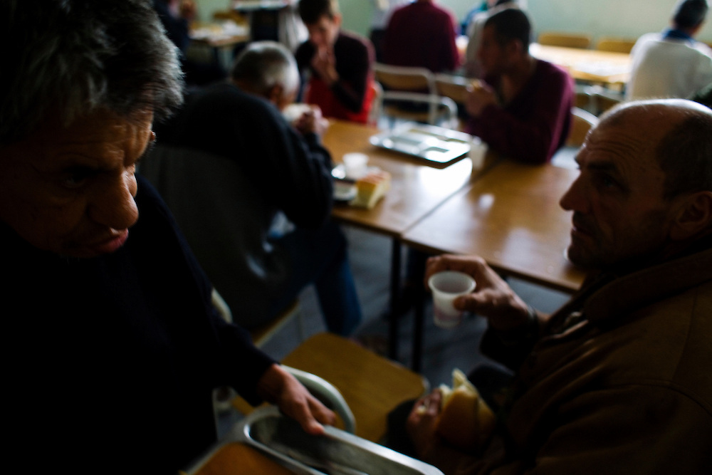Patients at a controversial, multi-racial Mental Hospital in Shtime, Kosovo. Though there are more than 40 patients at the facility there are huge budget problems and no on-site psychiatrists. Lunch time.