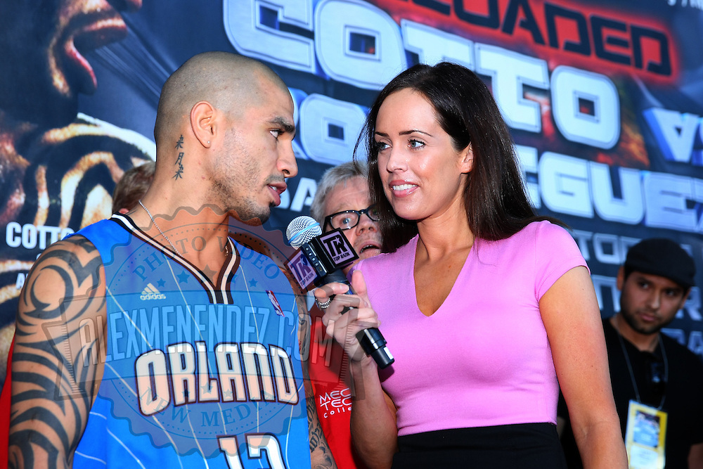 Miguel Cotto of Puerto Rico is seen being interviewed by Top Rank media after the official weigh in for a 12-round super welterweight bout against Delvin Rodriguez at the Amway Arena in Orlando, Florida on Friday, October 4, 2013.  Cotto (37-4, 30 KOs) a 3-time Champion, recently hired Hall of Fame trainer Freddie Roach for this  televised bout. (AP Photo/Alex Menendez)