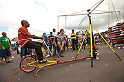 A young Puerto Rican girl rides an antique merry-go-round in Puerto Rico