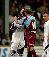 Photo: Jed Wee.<br /> Scunthorpe United v Swansea City. Coca Cola League 1. 08/08/2006.<br /> <br /> Tempers flare as Swansea's Leon Knight (L) receives a yellow card for scuffling with Scunthorpe's Ian Baraclough.