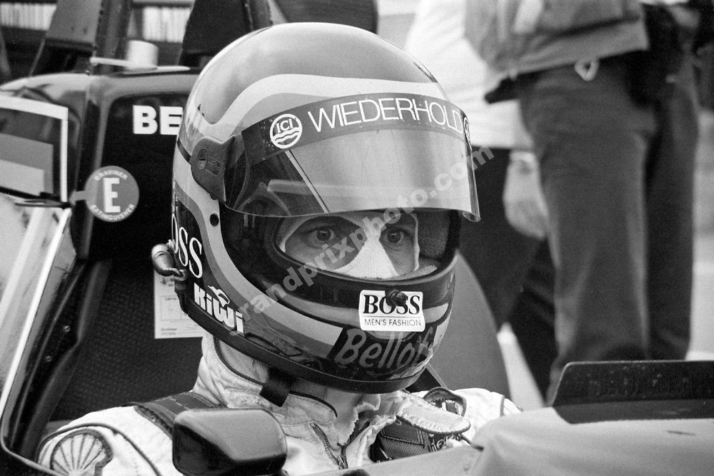 Stefan Bellof (Tyrrell-Ford) in the pits with his helmet on during practice for the 1984 Briritsh Grand Prix at Brands Hatch. Photo: Grand Prix Photo