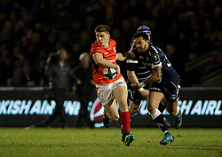 Saracens Owen Farrell breaks through as Sale Sharks Denny Solomona(right) tackles during the European Champions Cup, pool three mach at the AJ Bell Stadium, Salford. PRESS ASSOCIATION Photo. Picture date: Sunday December 18, 2016. See PA story RUGBYU Sale. Photo credit should read: Richard Sellers/PA Wire