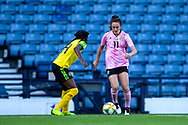 Lisa Evans (#11) of Scotland looks to take on Den-Den Blackwood (#14) of Jamaica during the International Friendly match between Scotland Women and Jamaica Women at Hampden Park, Glasgow, United Kingdom on 28 May 2019.