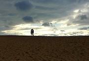 Jurassic Coast Dorset. couple at West Bay Beach