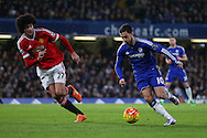 Chelsea's Eden Hazard and Marouane Fellaini of Manchester United during the Barclays Premier League match between Chelsea and Manchester United at Stamford Bridge, London, England on 7 February 2016. Photo by Ellie Hoad.