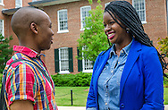 University of Mississippi students Nathaniel Weathersby and Renee Ombaba talk as they stand behind the Lyceum on campus, July 30, 2013, in Oxford, Miss. Ombaba helped organize a candlelight unity walk last fall after a racially-charged skirmish broke out in front of the Lyceum following the re-election of President Barack Obama. The Lyceum was also the site of violence in October 1962, when riots broke out after James Meredith enrolled as the first black student on campus. (Photo by Carmen K. Sisson/Cloudybright)