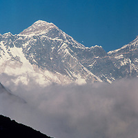 Mount Everst towers of a seated trekker in the Khumbu region of Nepal 1986.