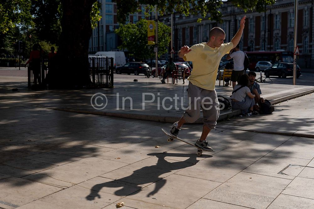 A man skateboarding at Windrush Square as temperatures reach low 30s across the capital on the 24th July 2019 in South London in the United Kingdom.