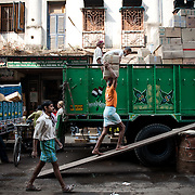 uploading a truck at Kolkata's fruit market